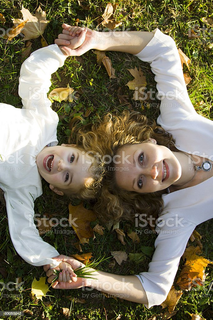 Mother and daughter playing in autumn park royalty-free stock photo