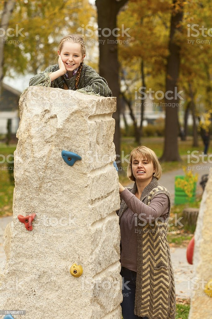 Mother and daughter playing in park royalty-free stock photo