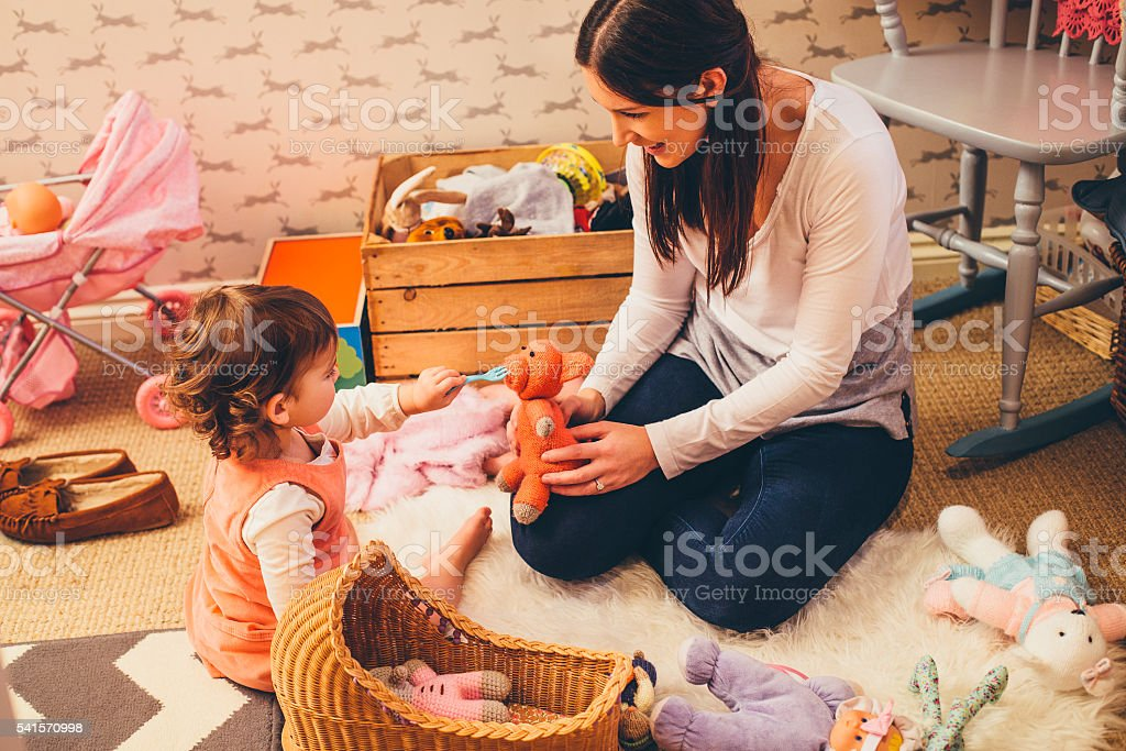 Mother and Daughter Playing stock photo
