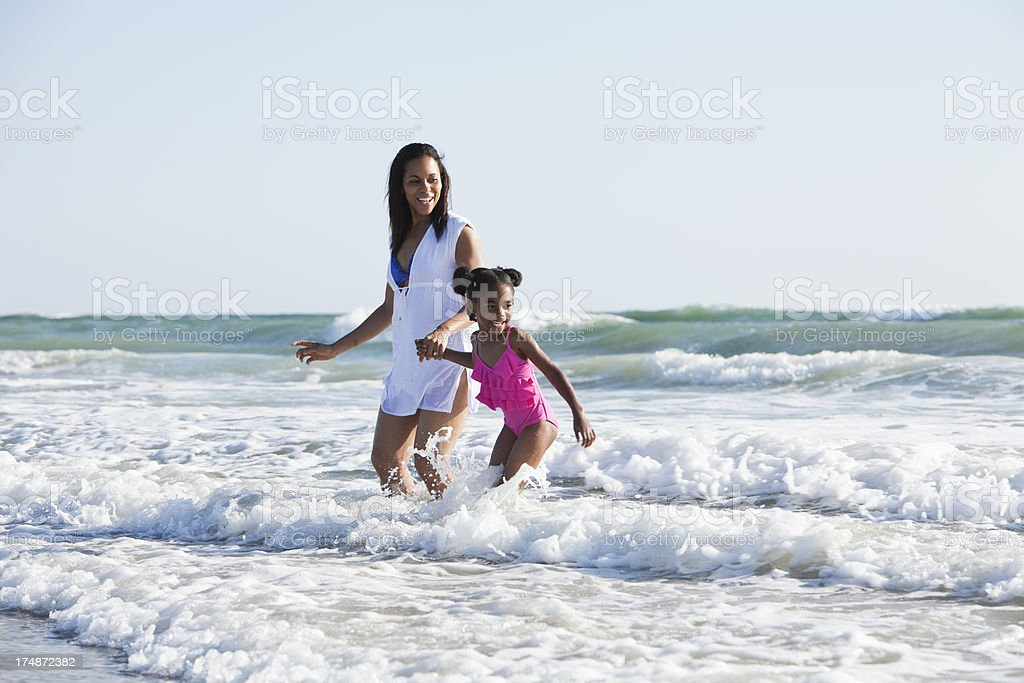 Mother and daughter playing surf stock photo