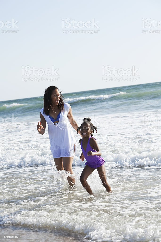 Mother and daughter playing surf royalty-free stock photo