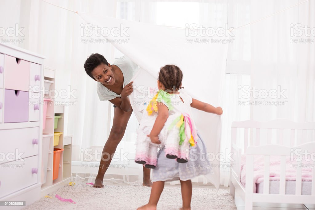 Mother and daughter playing time at home. stock photo