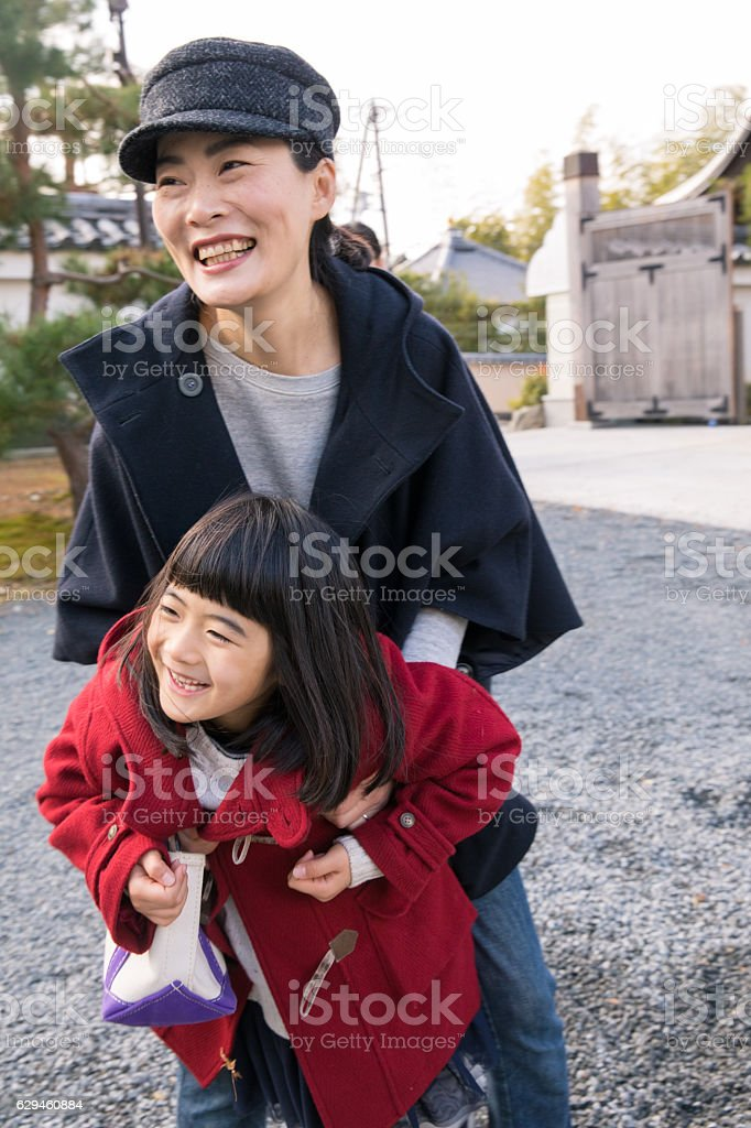 Mother and daughter playing together in temple stock photo