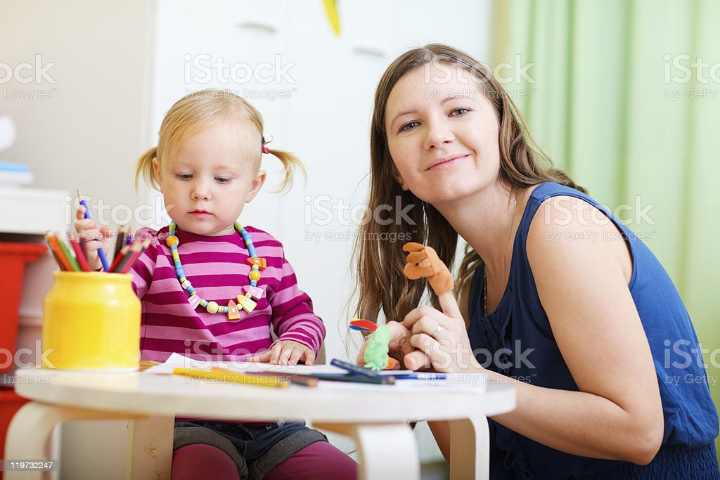 Mother and daughter playing together stock photo