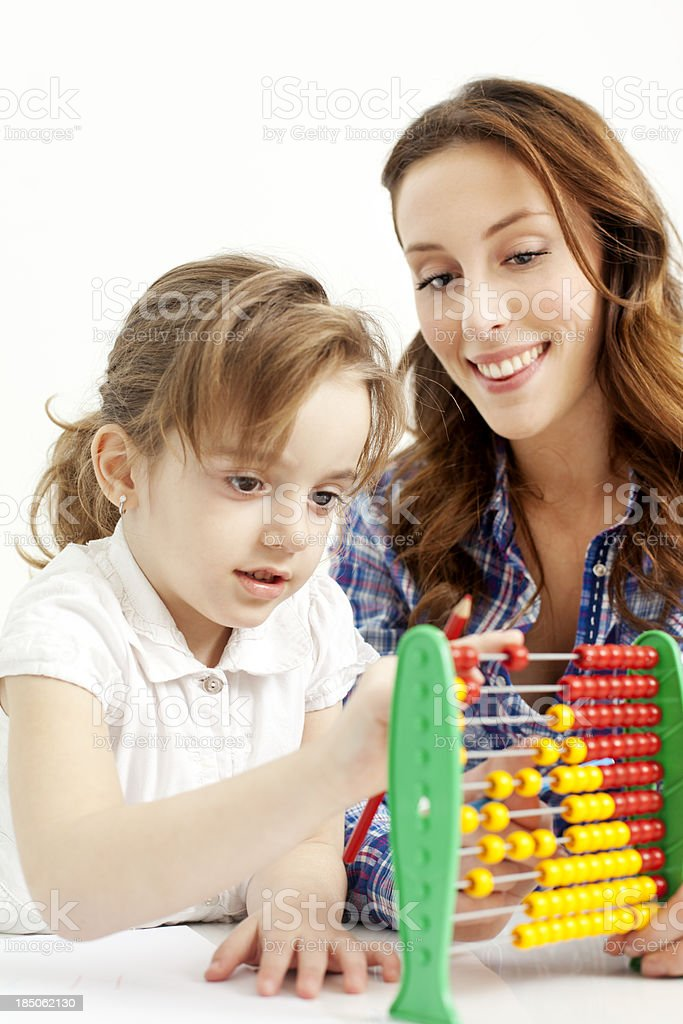 Mother and daughter playing together. royalty-free stock photo