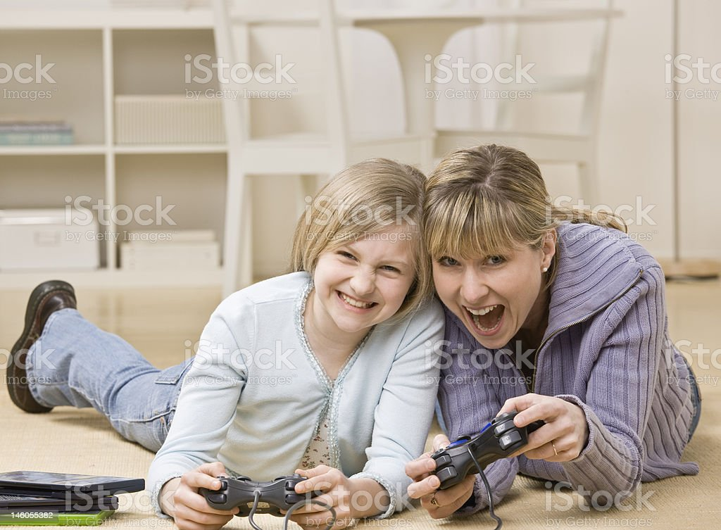 Mother and daughter playing video game royalty-free stock photo