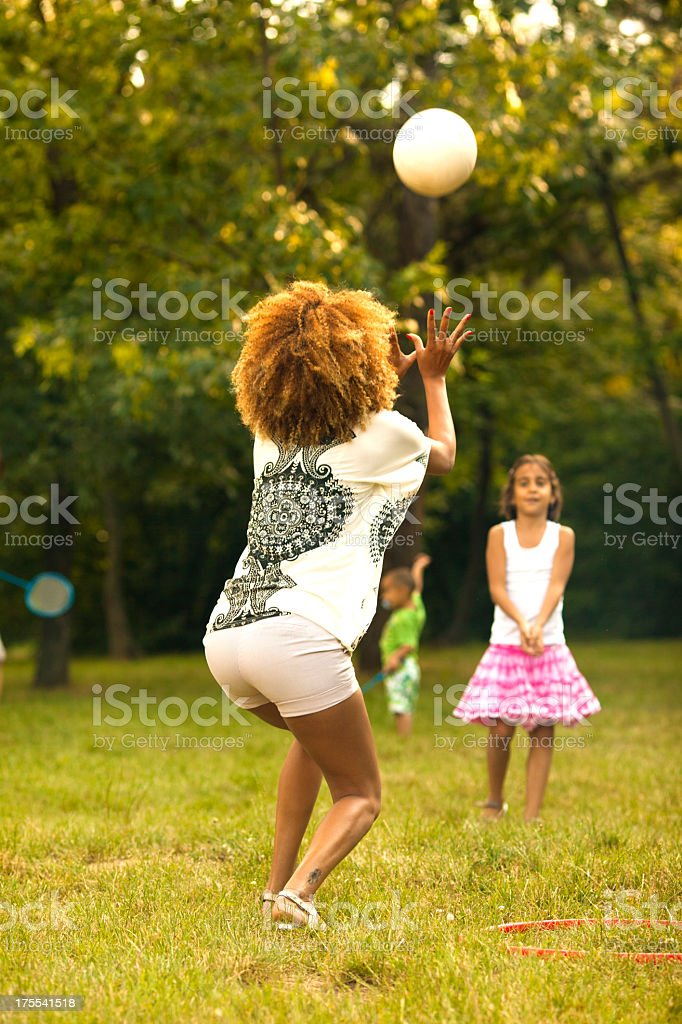 Mother and daughter playing volleyball outdoors. royalty-free stock photo