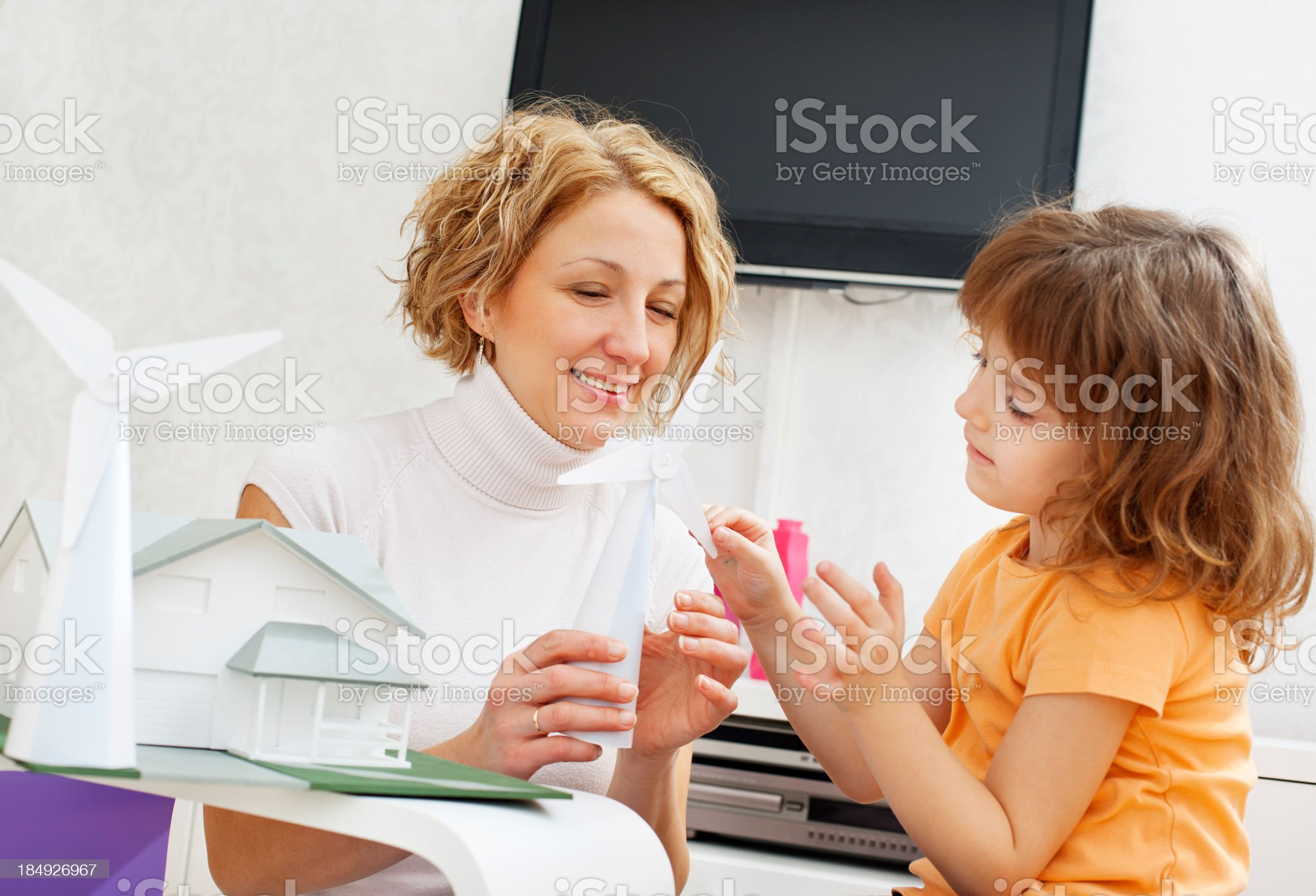Mother and daughter playing with windmill model royalty-free stock photo