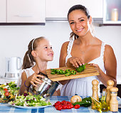 Mother and daughter prepare vegetables