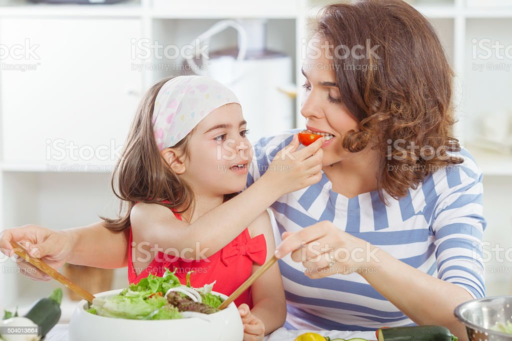 Mother and Daughter Preparing Food stock photo