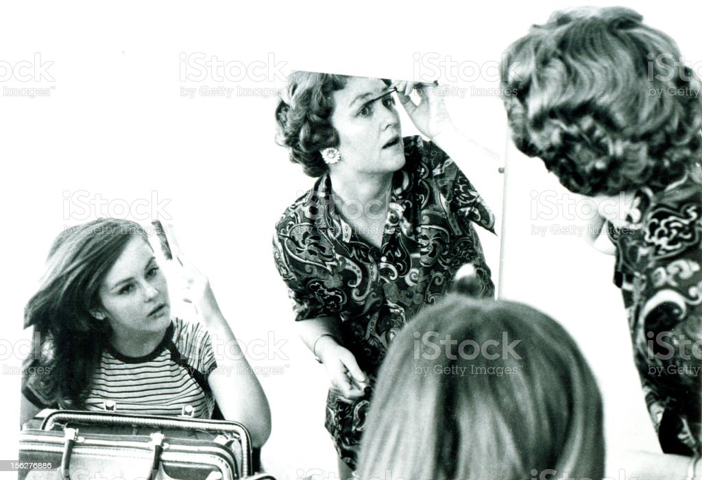 Mother and Daughter Putting on Make-up in Mirror, Vintage royalty-free stock photo