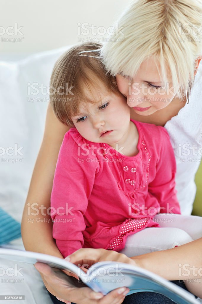 Mother and daughter reading a book royalty-free stock photo