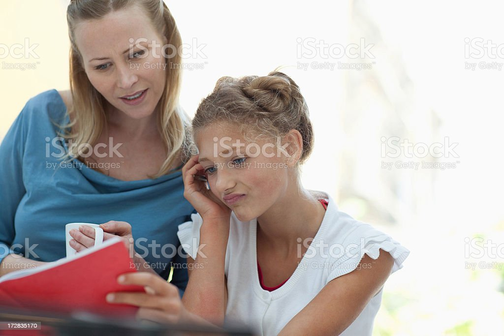 Mother and daughter reading book royalty-free stock photo