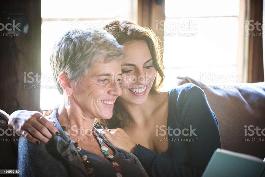 Mother and Daughter Reading on Sofa stock photo