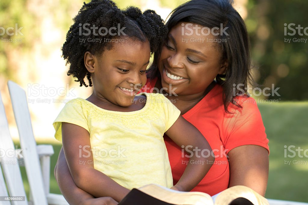 Mother and daughter reading stock photo