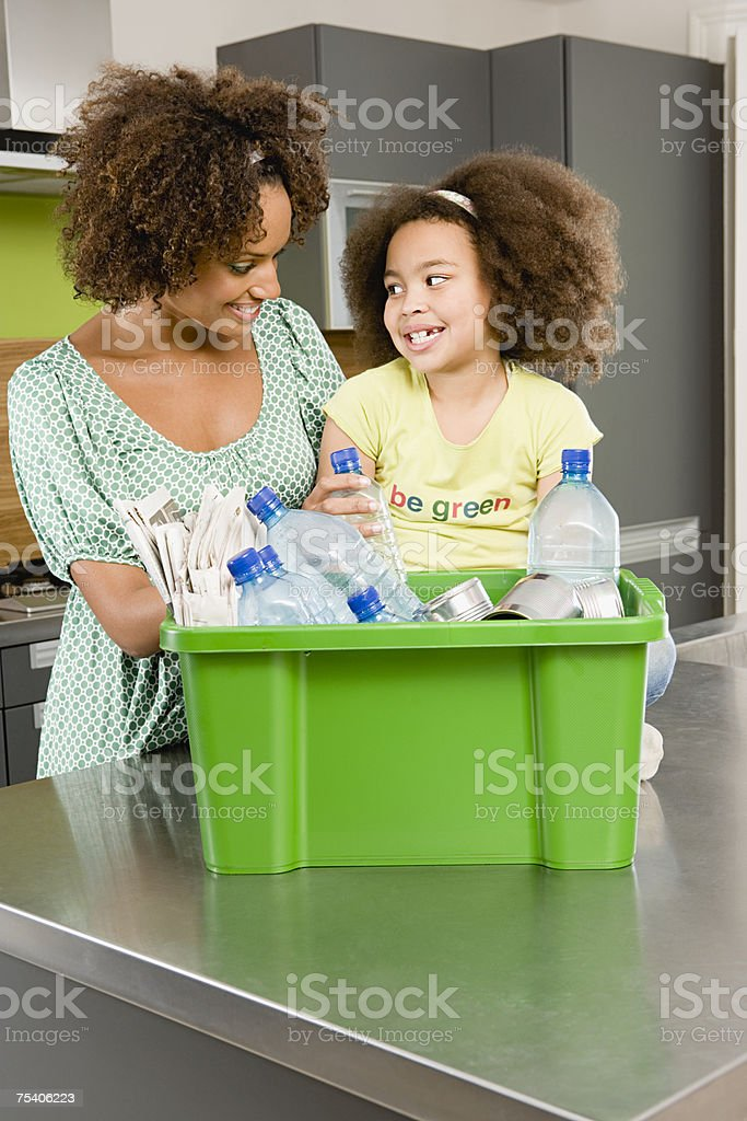 Mother and daughter recycling royalty-free stock photo