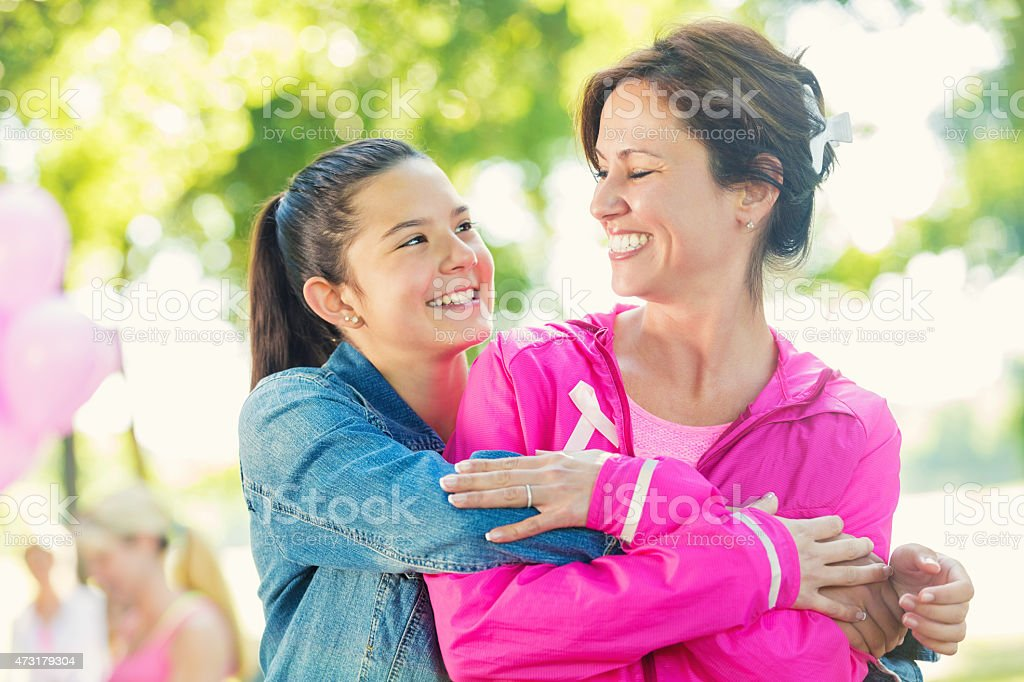 Mother and daughter registering for breast cancer awareness charity race stock photo