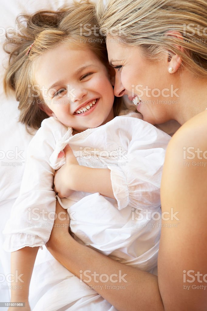 Mother And Daughter Relaxing In Bed royalty-free stock photo