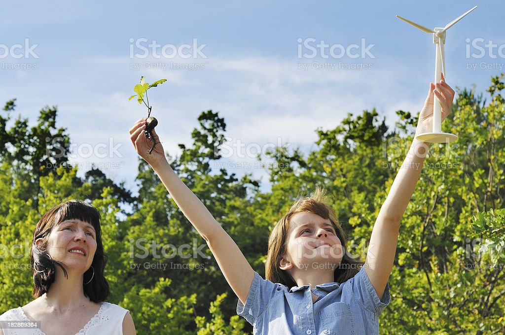 mother and daughter see green future royalty-free stock photo