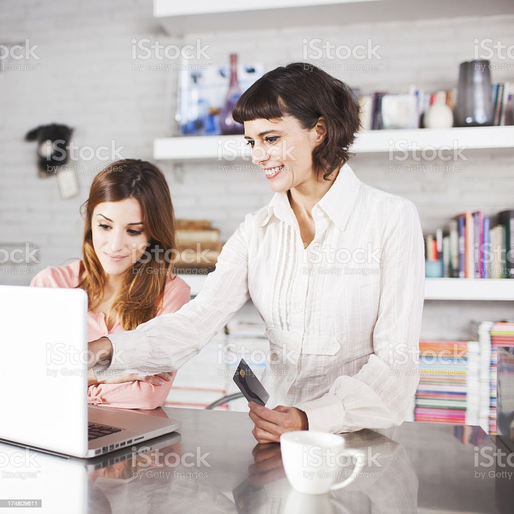 Mother and daughter sharing a laptop. royalty-free stock photo