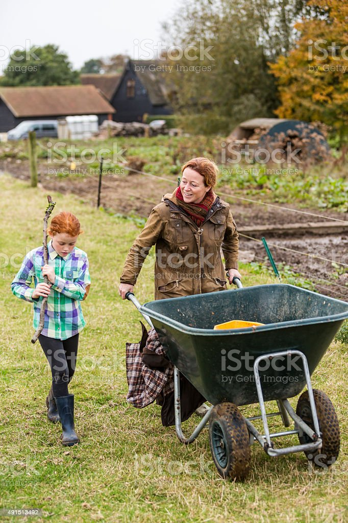 Mother and Daughter Sharing Moment While Working an Organic Farm stock photo
