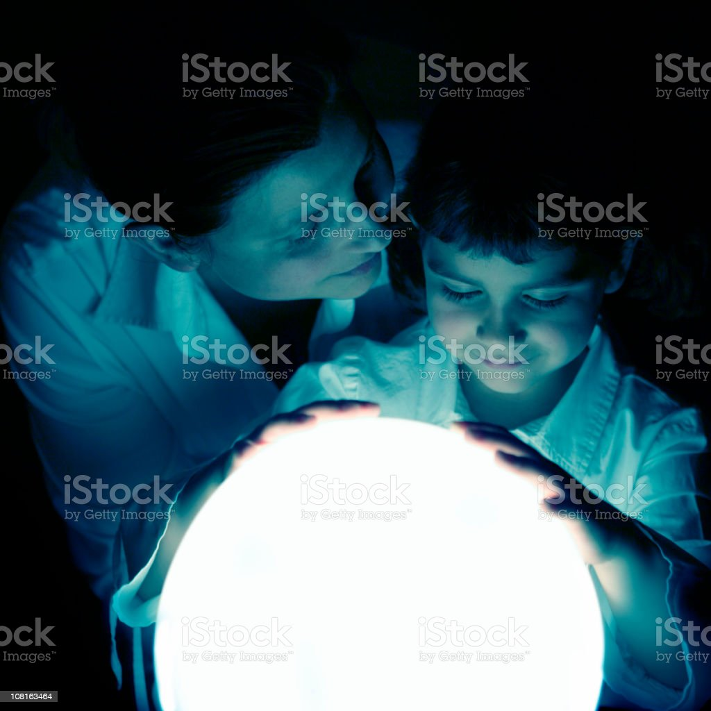 Mother and Daughter Sharing Moment with Glowing Globe royalty-free stock photo