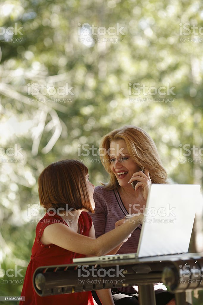 Mother and Daughter Shopping online royalty-free stock photo