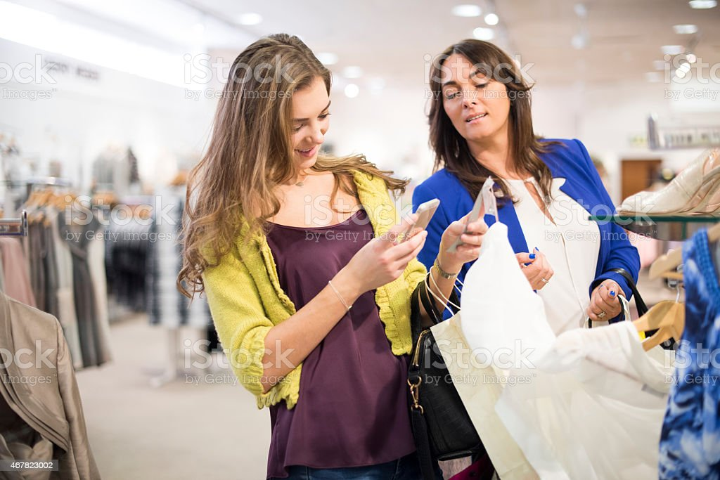 mother and daughter shopping with qr codes stock photo