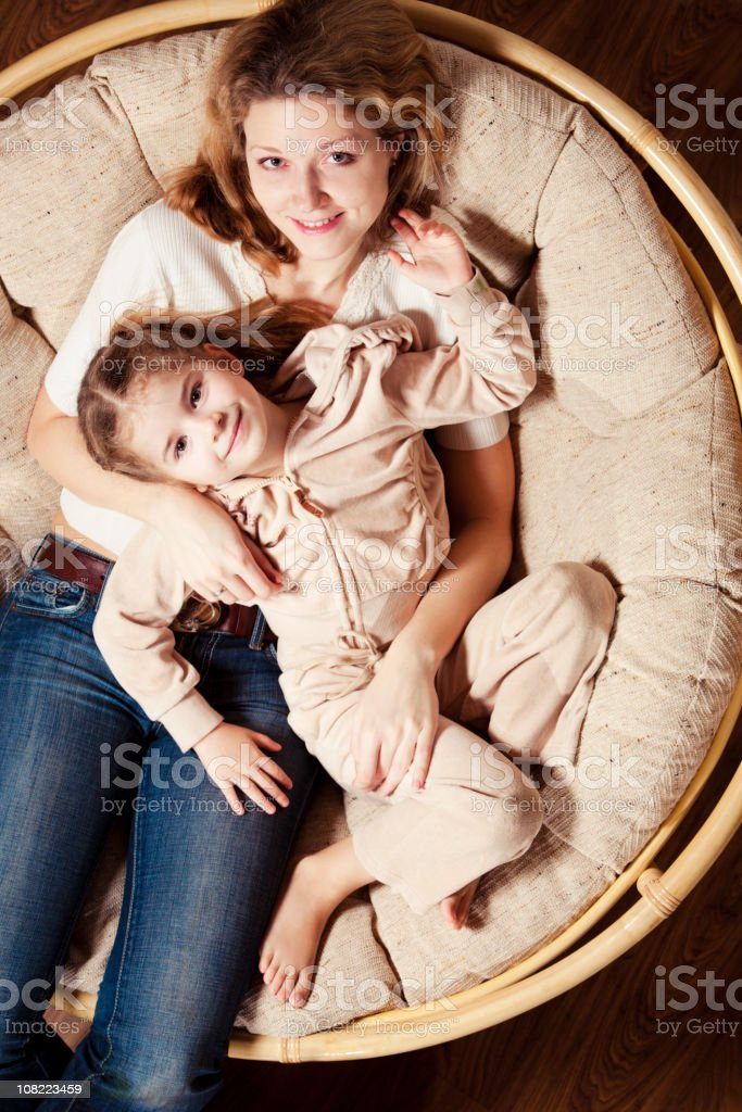 Mother and Daughter Sitting in Dome Chair royalty-free stock photo