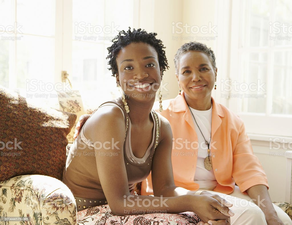 Mother and daughter sitting on couch royalty-free stock photo