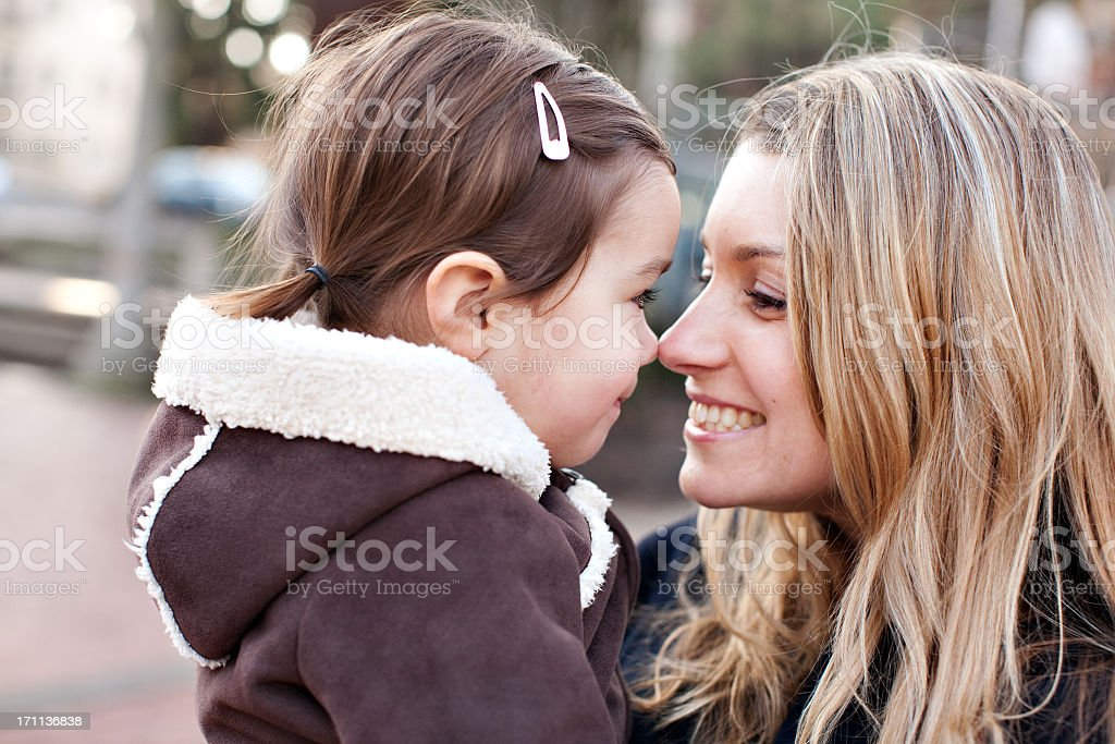 A mother and daughter sitting outdoors royalty-free stock photo