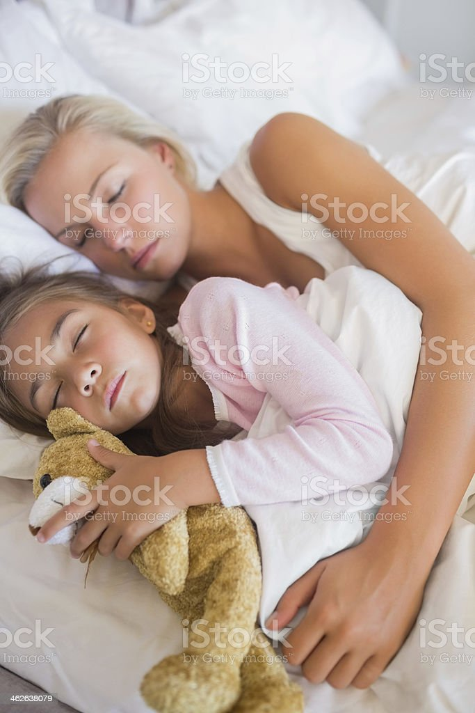 Mother and daughter sleeping toghether royalty-free stock photo