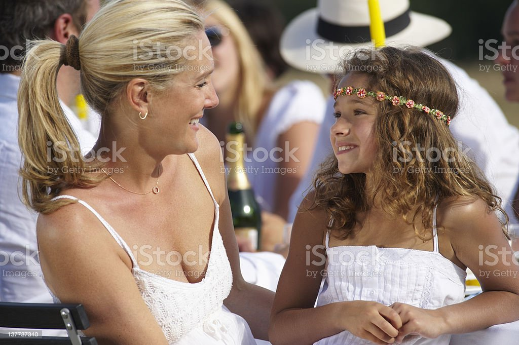 Mother and daughter smiling at table royalty-free stock photo