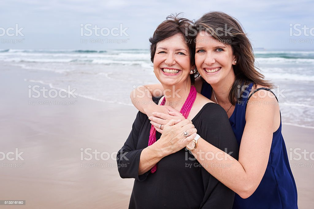 Mother and daughter smiling happily at the caemra stock photo