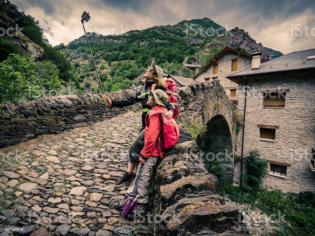 Mother and daughter stating trek and taking a selfie photograph stock photo