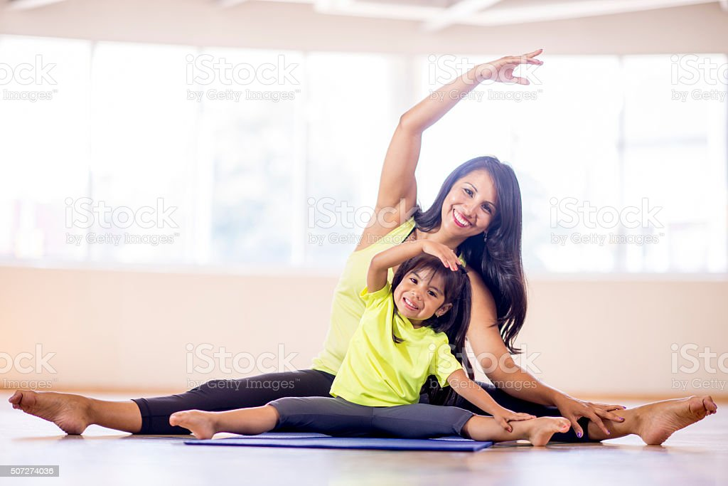Mother and Daughter Stretching at the Gym stock photo