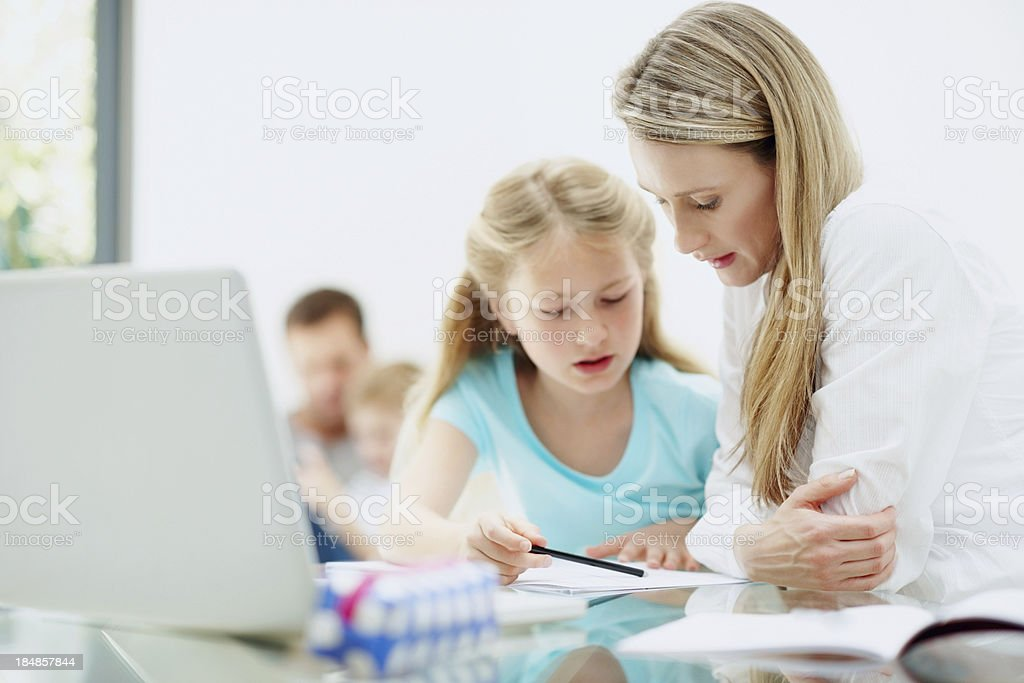 Mother and daughter studying at home royalty-free stock photo