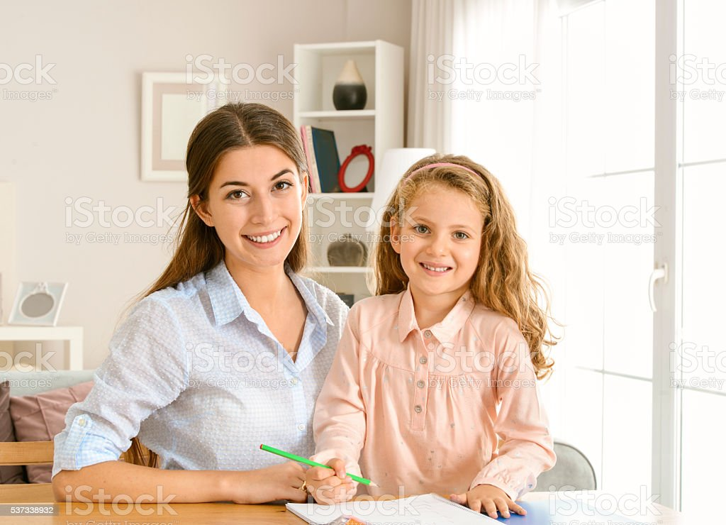 Mother and daughter studying stock photo
