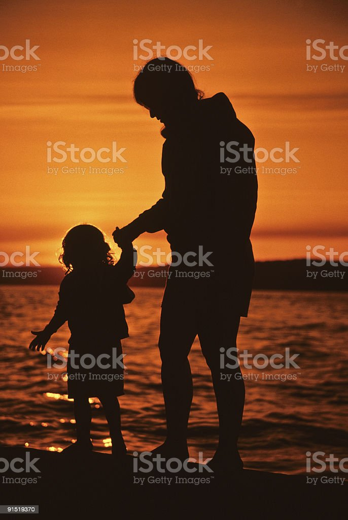 Mother and Daughter, Sunset Silhouette royalty-free stock photo