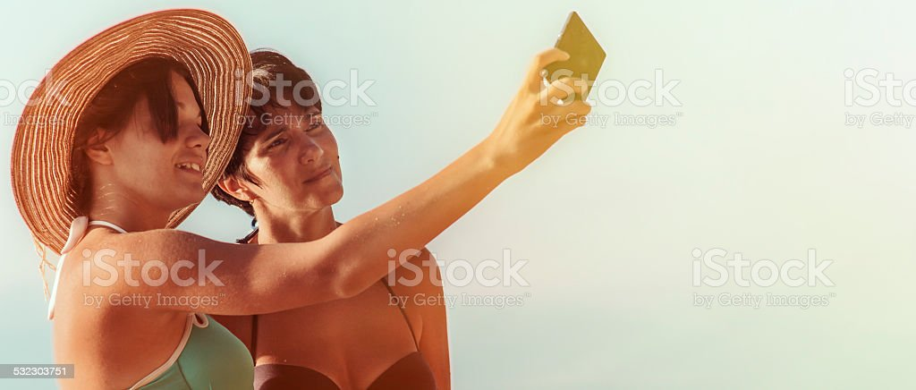 Mother and daughter takig selfie stock photo