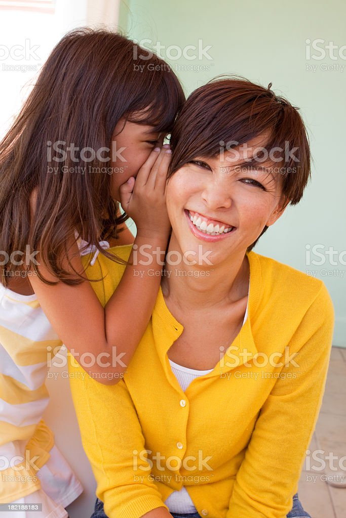Mother and daughter telling secrets royalty-free stock photo