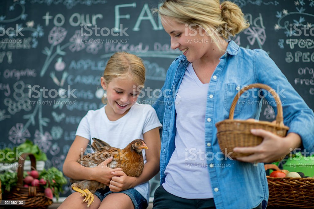 Mother and Daughter Together at the Market stock photo