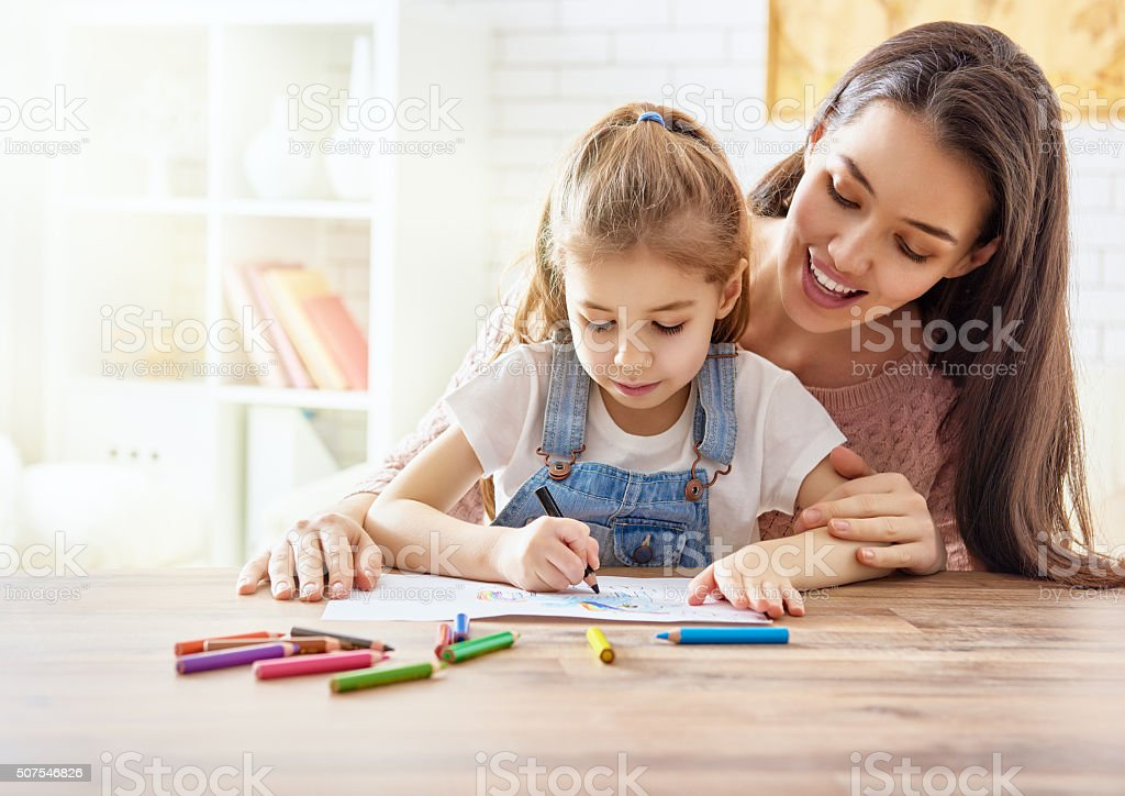 Mother and daughter together paint stock photo