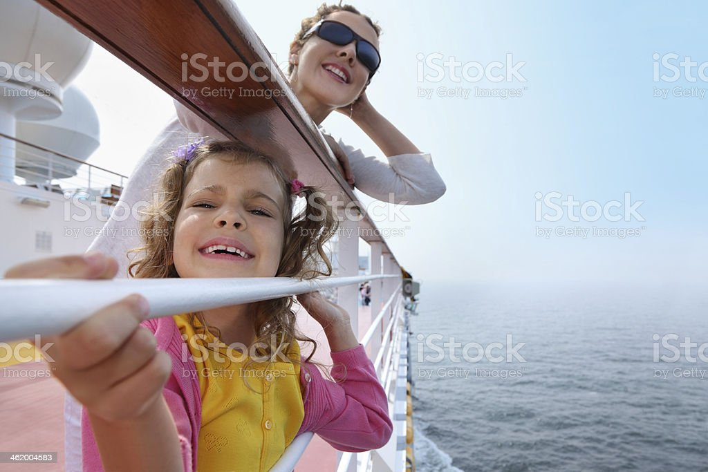 Mother and daughter traveling on cruise ship stock photo