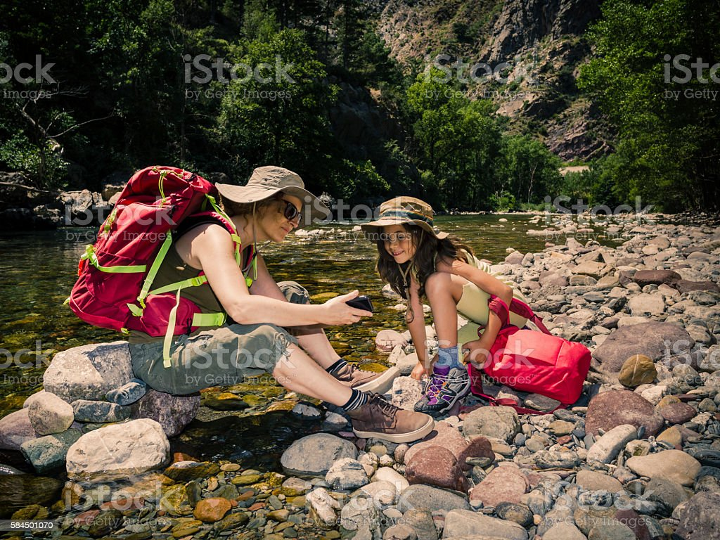 Mother and daughter trekking stock photo