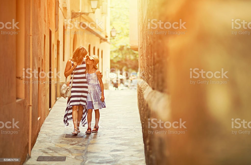 Mother and daughter visiting mediterranean city of Palma stock photo