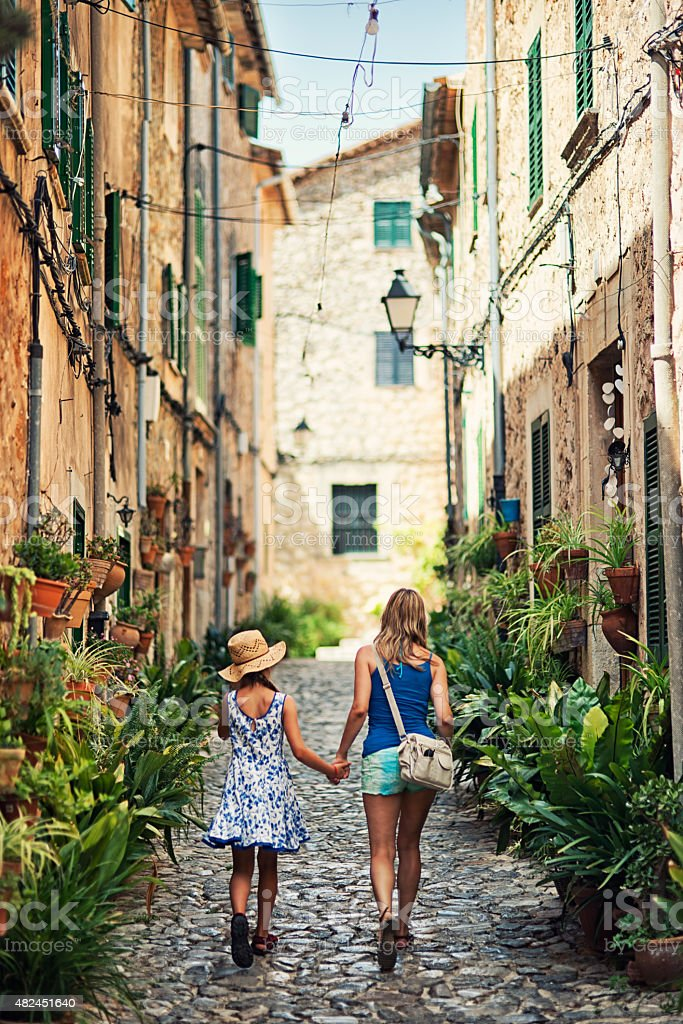 Mother and daughter visiting mediterranean town of Valldemossa stock photo