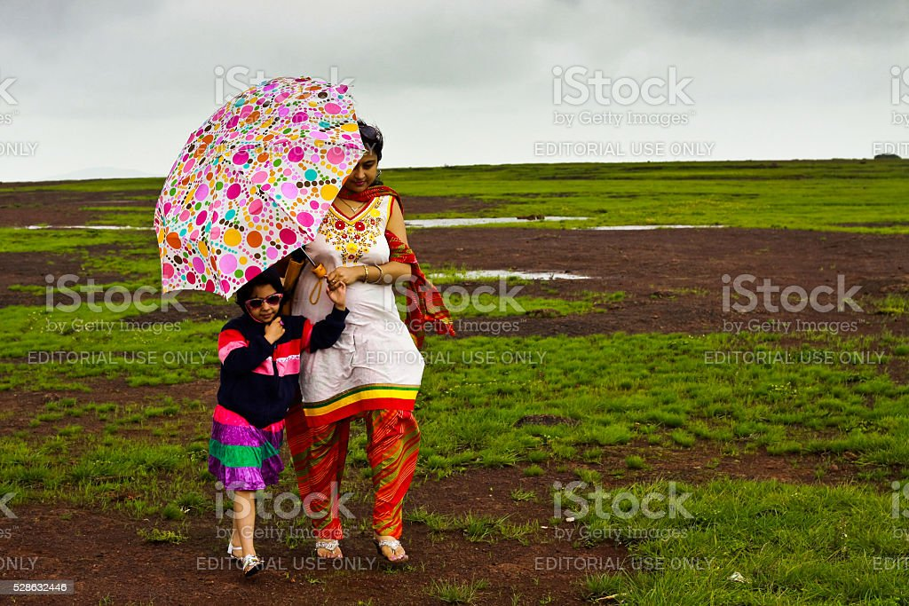 Mother and Daughter walking in a stormy morning stock photo