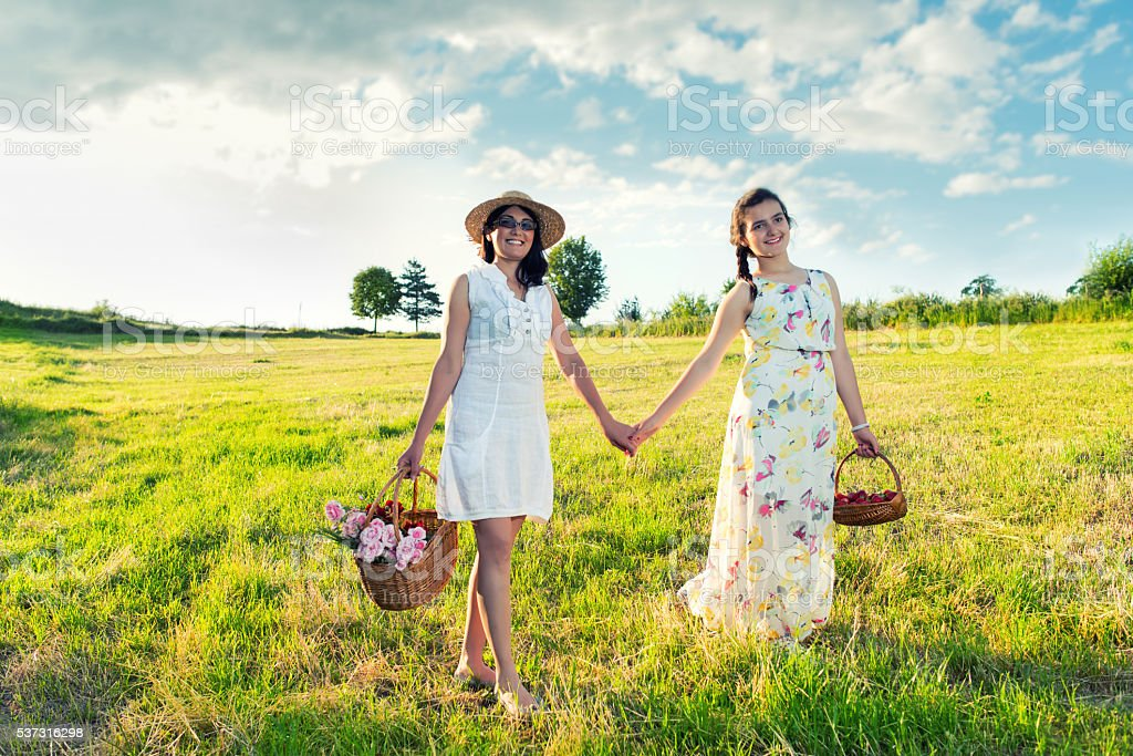 Mother and daughter walking together in nature stock photo
