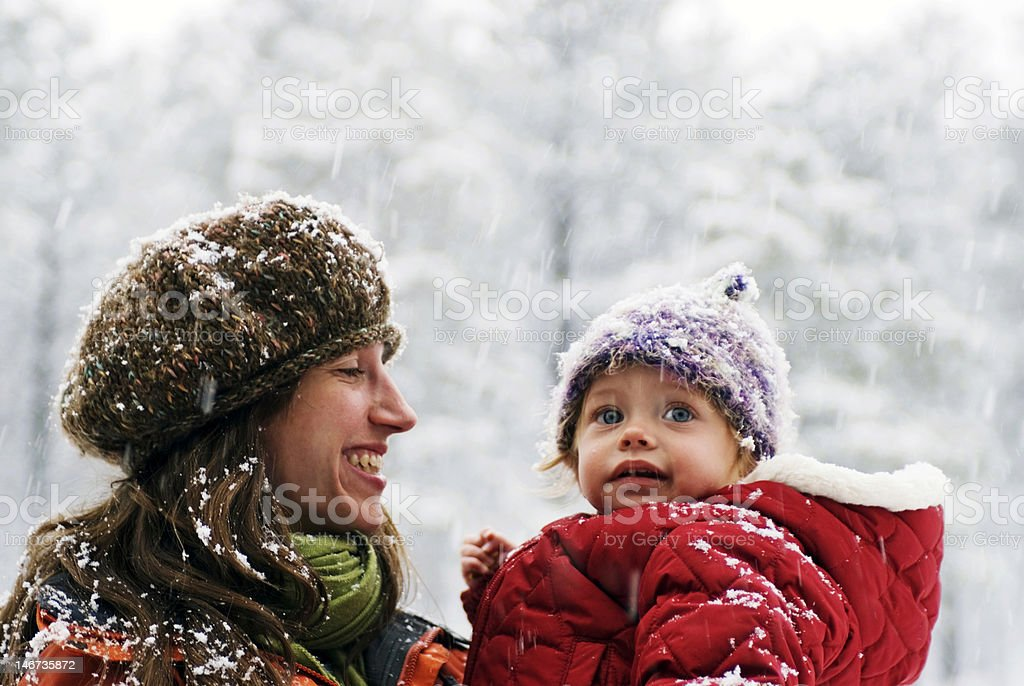 Mother and daughter watching snowflakes royalty-free stock photo